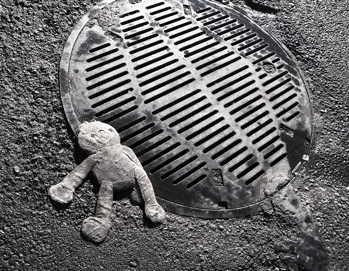 Crushed Doll on Manhole
