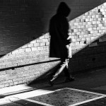 Hooded Figure in Shadow