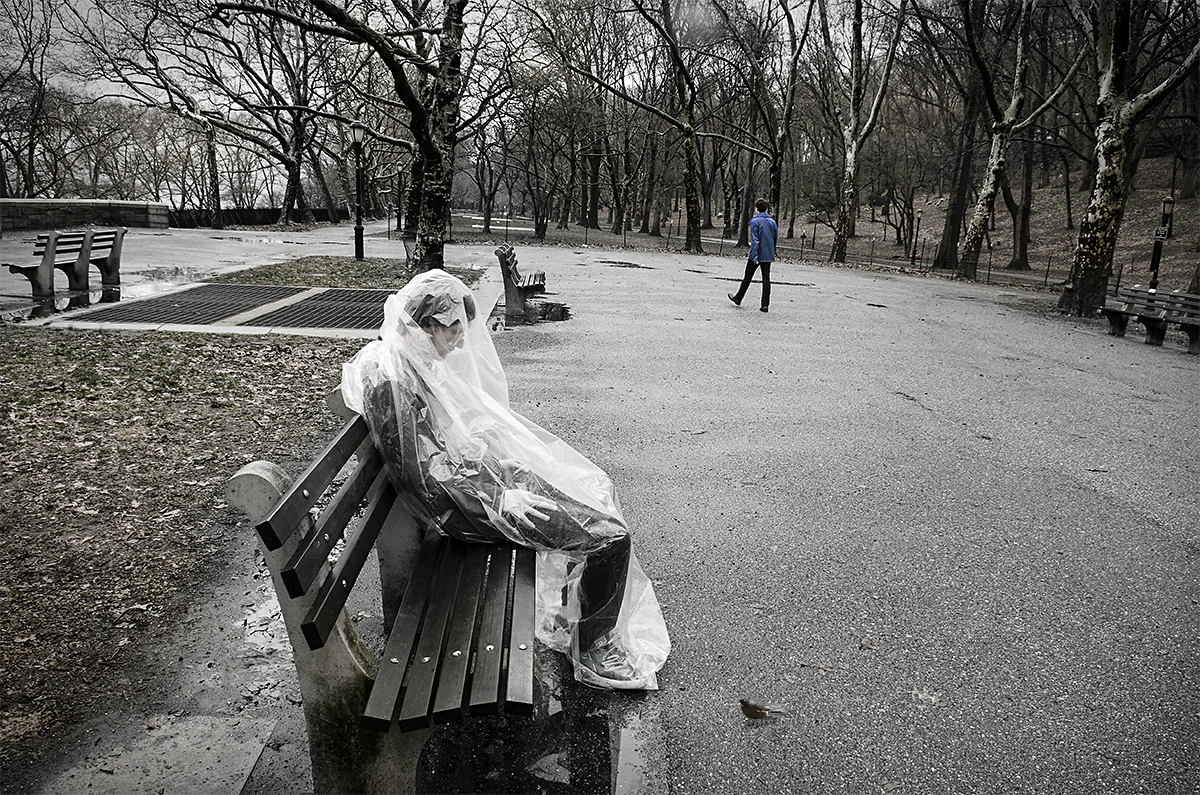 Man in Bag on Bench with Bird