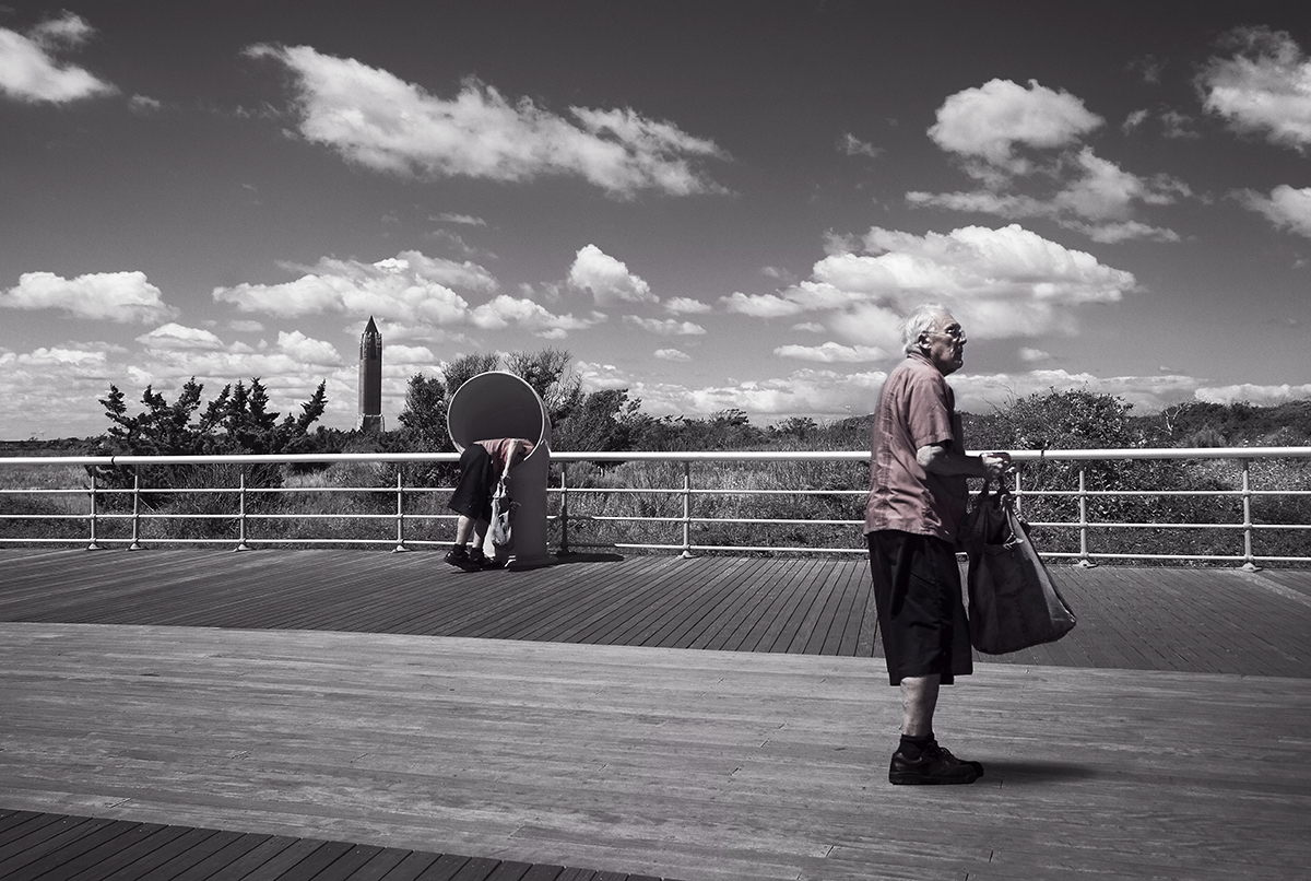 Man on Boardwalk with Bag